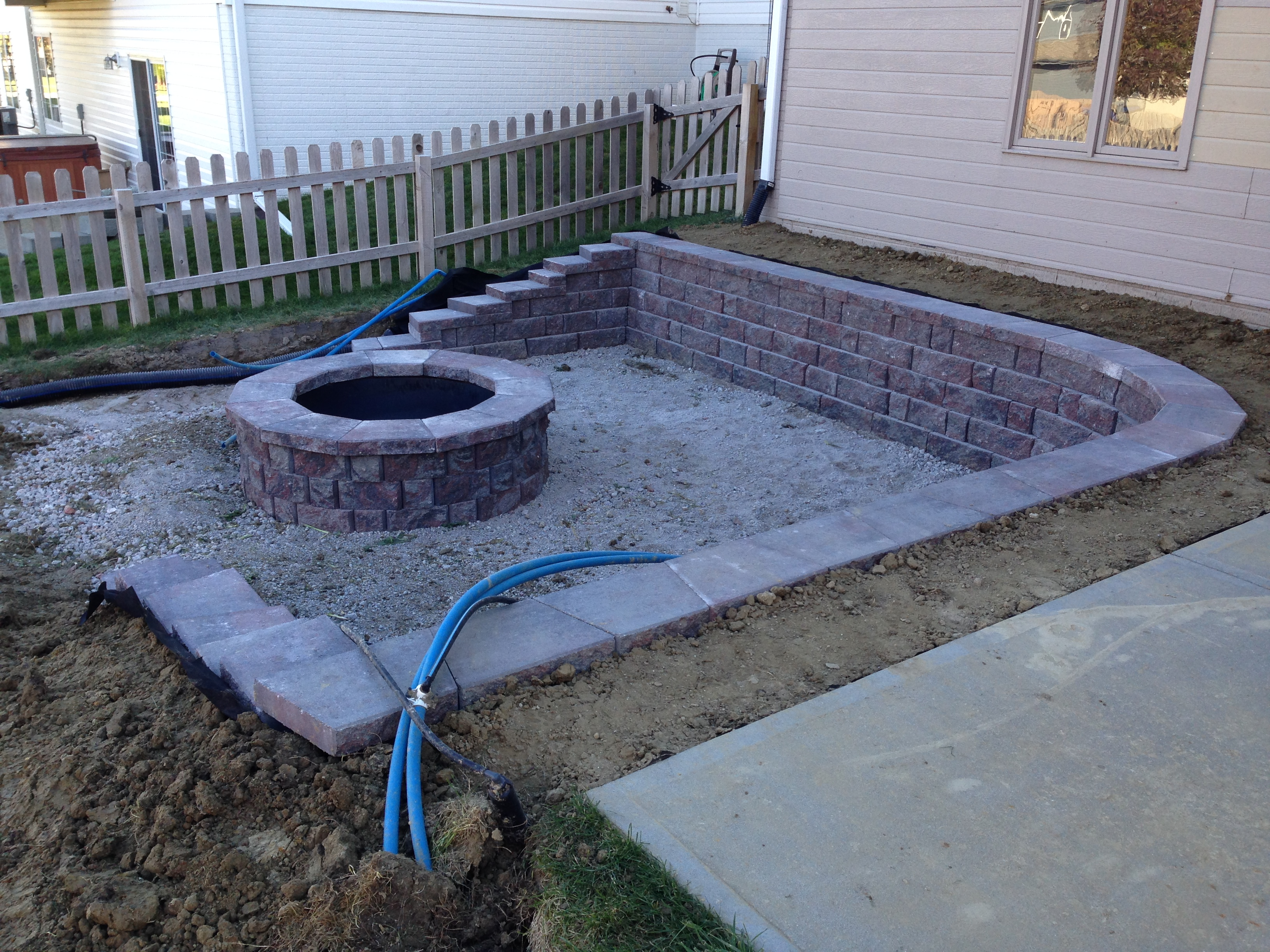 Exterior Wall Drainage : Outdoor living water drainage concrete retaining wall