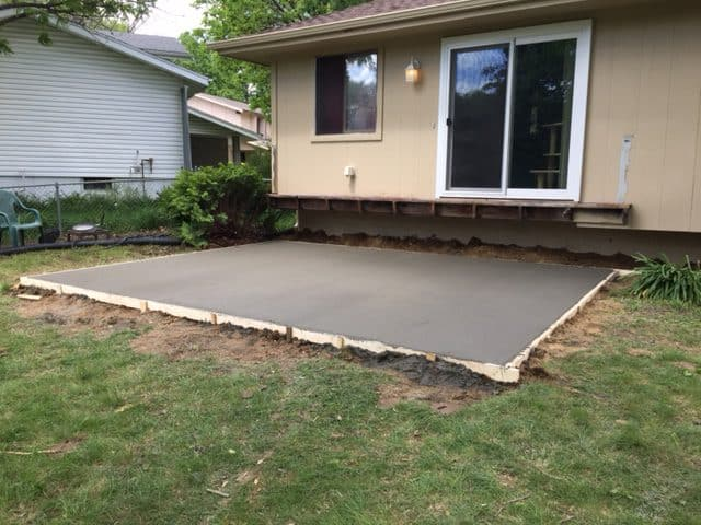 Concrete Patio Southwest Omaha Water Drainage Retaining Wall Siding Roofing Contractor