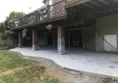 Stamped and Colored Concrete Patio Under Deck