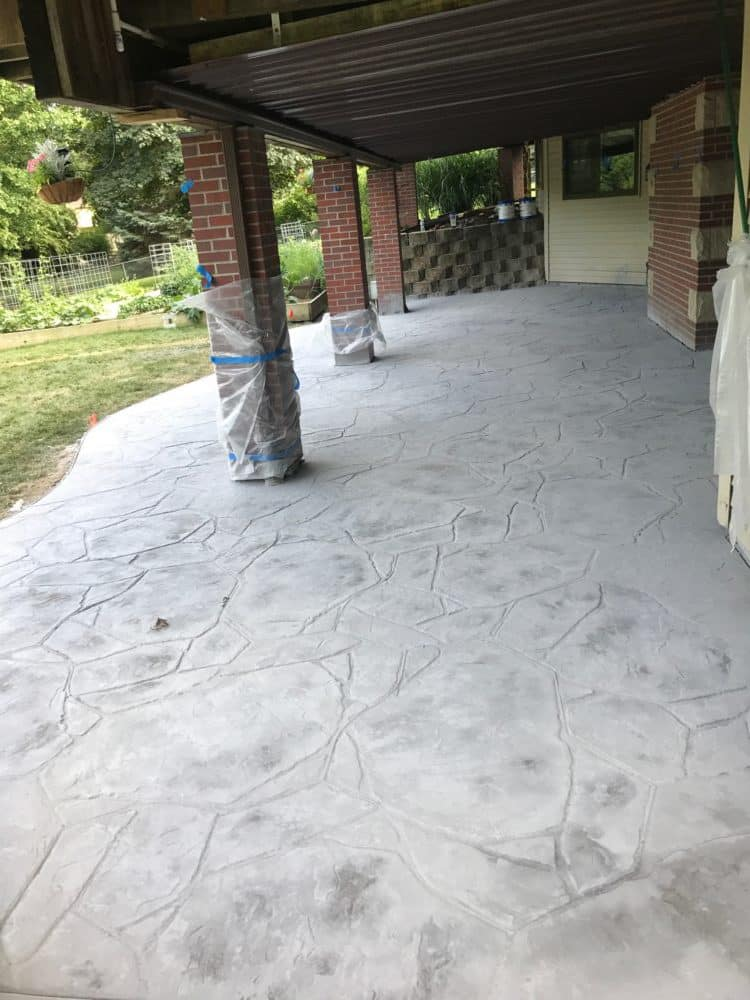 Stamped And Colored Concrete Patio Under Deck   Water Drainage Concrete  Retaining Wall Siding U0026 Roofing Omaha Contractor